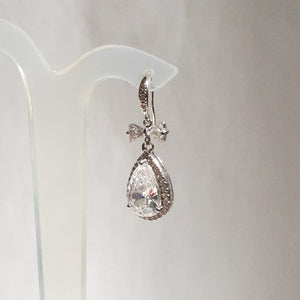 Cubic Zirconia crystal clear heart, bow and pear shaped drop silver-tone stud earrings