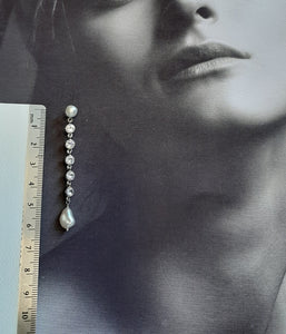 Freshwater pearls and crystal clear cubic zirconia's multi drop stud earrings