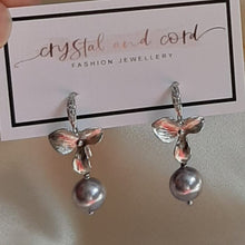 Load image into Gallery viewer, Swarovski crystal pearl and small shiny silver-tone orchid shaped flower drop earrings