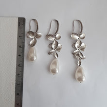 Load image into Gallery viewer, Silver or gold tone, cubic zirconia earwires and orchid shaped flowers with Swarovski crystal baroque pearl drop earrings