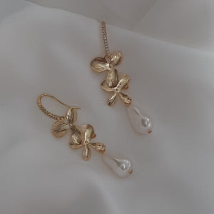 Silver or gold tone, cubic zirconia earwires and orchid shaped flowers with Swarovski crystal baroque pearl drop earrings