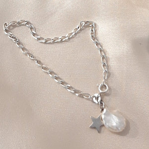 Sterling Silver curb chain, star and freshwater pearl charm bracelet