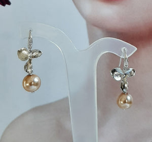 Faux pearl and small shiny silver-tone orchid shaped flower drop earrings