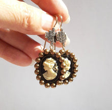 Load image into Gallery viewer, Cameo antiqued brass pearls and cross drop earrings