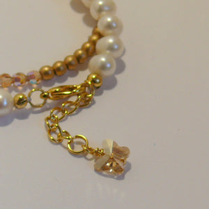 Golden shadow Swarovski crystal long cascading gold-tone earrings and bracelet SET