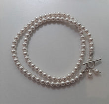 Load image into Gallery viewer, Swarovski crystal pearls sterling silver filled clasp and charm bracelet