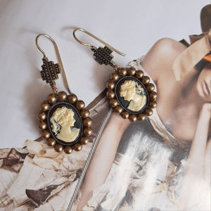 Cameo antiqued brass pearls and cross drop earrings
