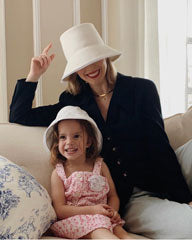 Kerry Pieri and Daughter in Matching White Hats by Genevieve Rose Atelier