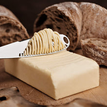 Load image into Gallery viewer, A Multi-function Keklle Stainless Steel Butter Knife with a Serrated Edge, Shredding Slots, a Butter Scooper and an Ergonomic Handle. Bread Cutter, Butter Curler and Spreader. Silver color. Durable.