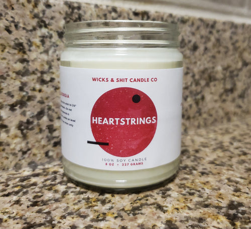 Heartstrings Candle- An enchanting scent of rose petal, cedar & musk that captivates the senses.