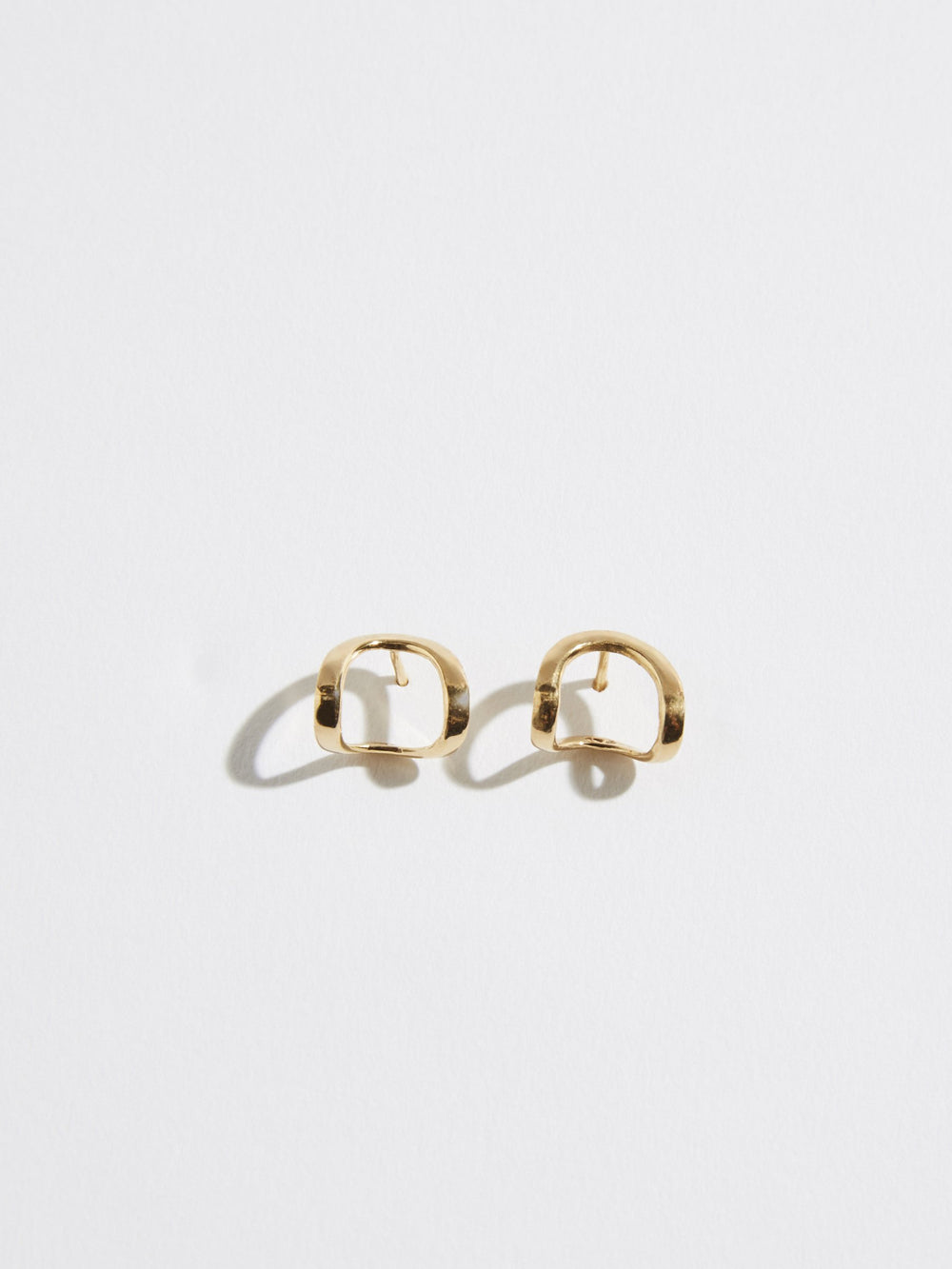 pigna gold arch earrings
