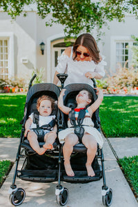 Children in duo stroller