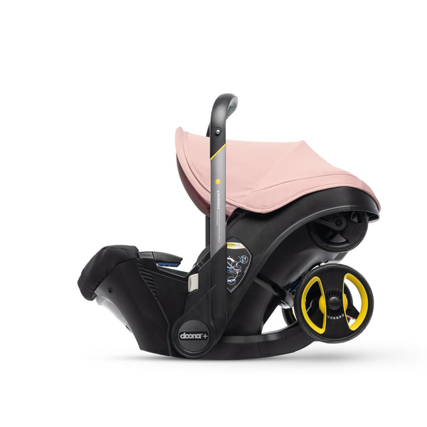 Doona in car seat mode with pink canopy