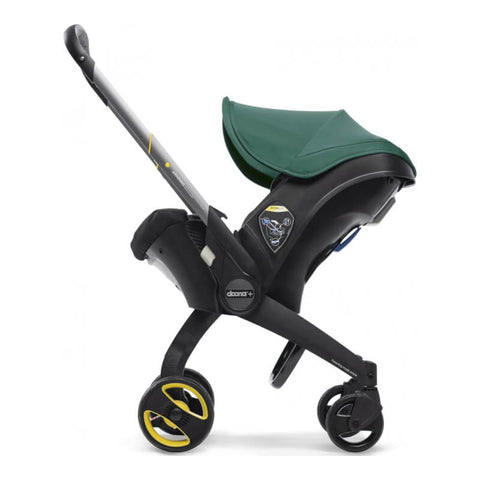 Doona car seat in stroller mode with green sun canopy