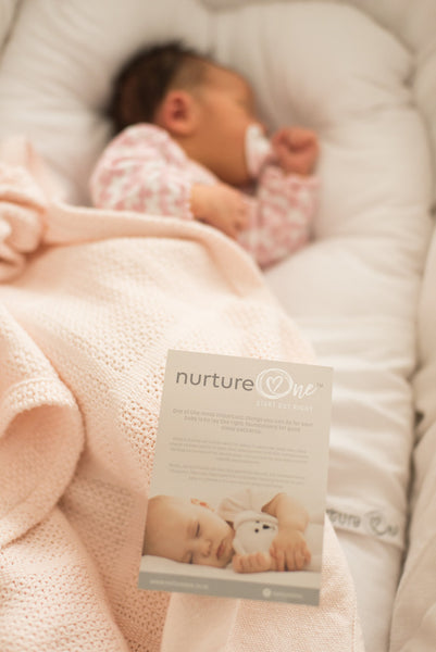Nurture One Nesting Pillow with Baby Sleeping on her side