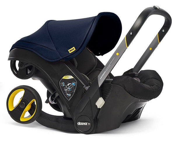 Doona in car seat mode with navy sun canopy