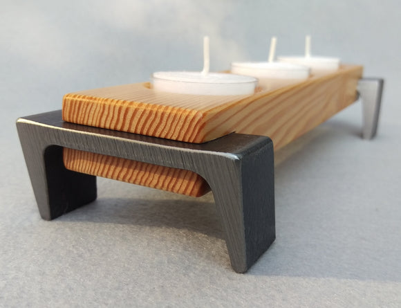 Light toned wooden tea light candle tray, 3 candle capacity, with dark metal angled legs on each end