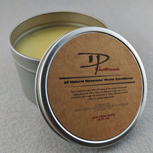 Open metal tin of DPCustoms beeswax wood conditioner