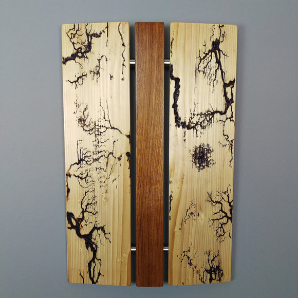Wood Wall art with three vertical panels. Electrical arc patterns burnt into outer panels, center section is orange brown wood