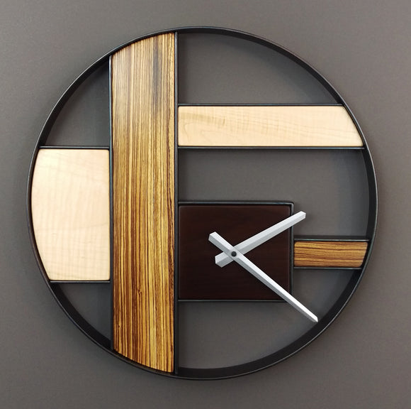 Round black metal frame wall clock with irregular grid of Zebrawood and Figured maple