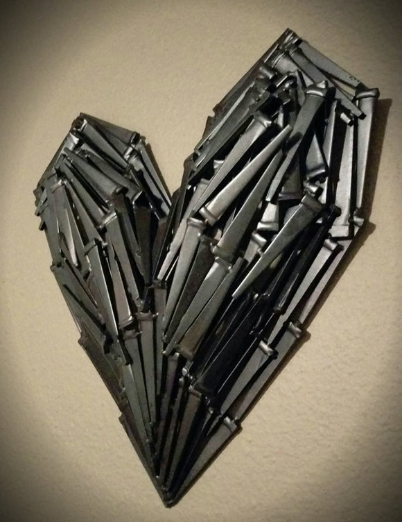 3D Metal heart sculpture, made from layers of welded black nails