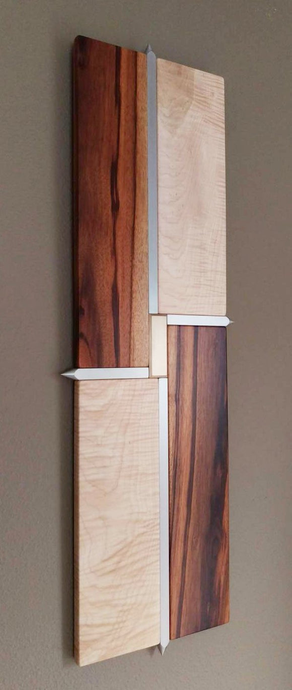 wood and metal wall art, light maple and orange tigerwood rectangles, separated by silver brushed aluminum spiked dividers, bronze tile in center