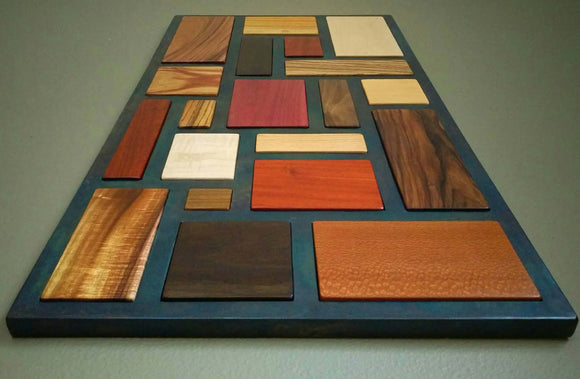 Multicolored wood mosaic, with black steel lattice separating each type.