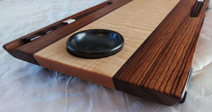 Long 2 person wooden sushi board. center wood is figured maple with zebrawood sides. chopstick grooves in zebrawood, and inset black ceramic sauce dishes on ends