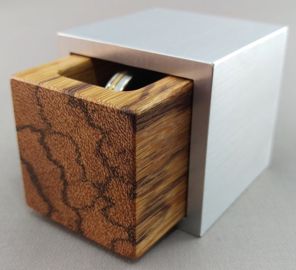 Cube shaped engagement ring box, silver aluminum shell with black streaked marblewood insert