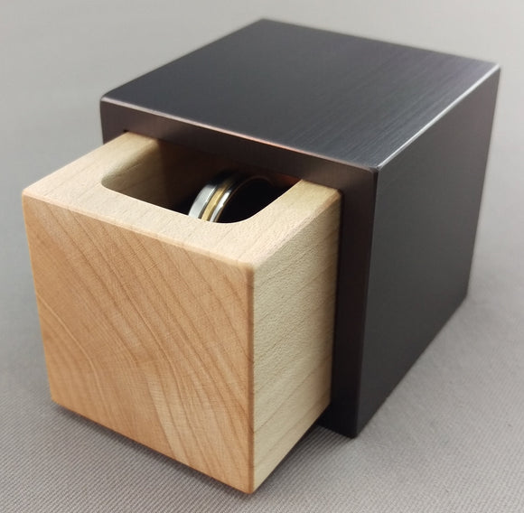 Modern Cube shaped ring box with gun metal grey exterior, and white maple insert
