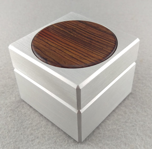 Silver aluminum engagement ring box, with circular cocobolo wood inlay on top of lid