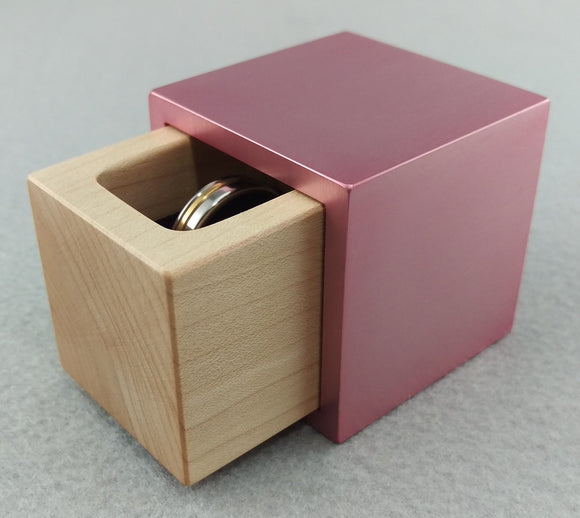 Cube metal and wood engagement ring box, pink outer shell with sliding white maple insert