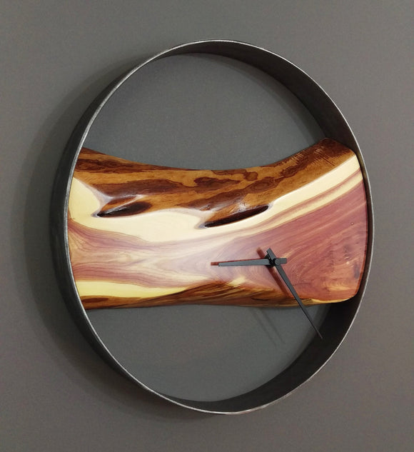 round wall clock,  black steel frame with horizontal dark red and cream juniper wood slab