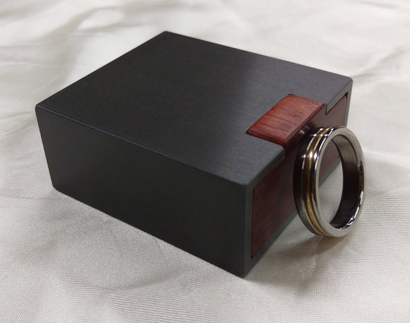 Slim engagement ring box, dark gunmetal grey, with red bloodwood wooden interior.