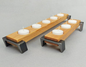 Light Brown wooden tea light holder set, with black angled legs on each end
