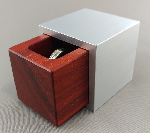 Cubed shaped engagement ring box with a red african padauk wood insert