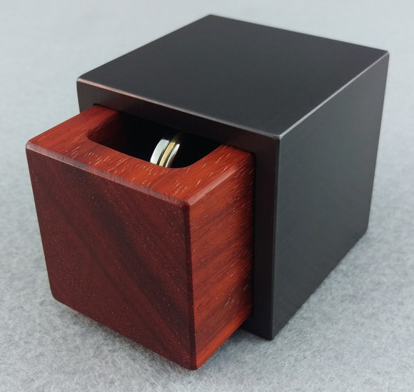 Cube metal and wood engagement ring box, Black metal outer shell with red wood insert