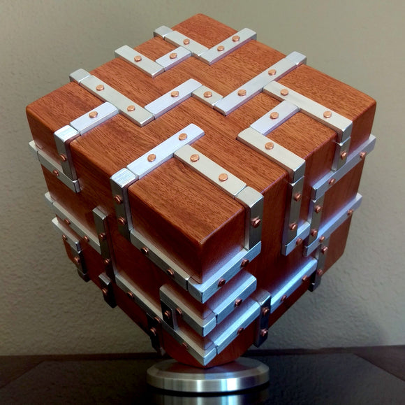 Wooden Cube sculpture with grid of silver aluminum inlays that are fastened onto wood with copper nails