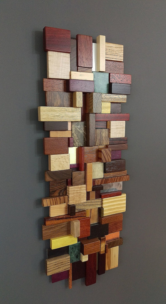 Small multi colored wood and metal mosaic, made with a variety of exotic woods