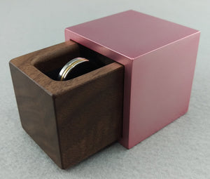 Modern cube shaped pink engagement ring box with black walnut wood insert