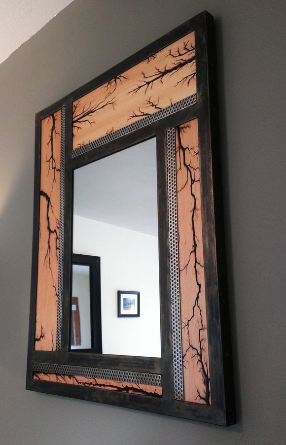 Dark metal frame wall mirror, pinwheel wood tiles have lichtenberg figures burnt in, stainless steel accents