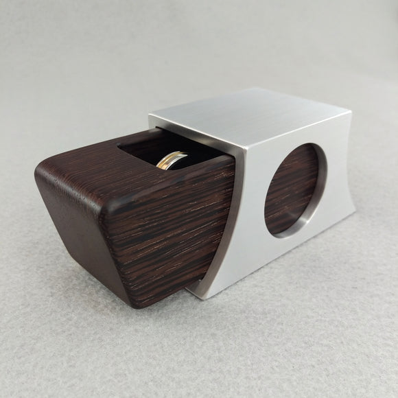 Silver metal engagement ring box with dark brown sliding wood insert