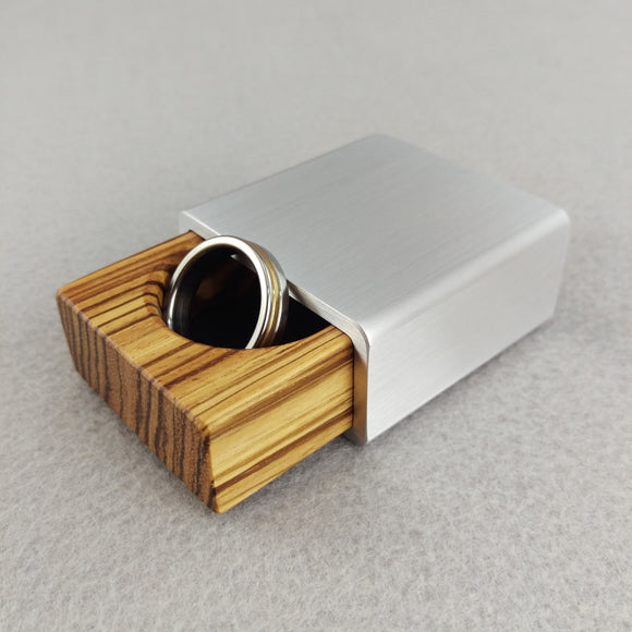 silver metal engagement ring box with zebrawood insert