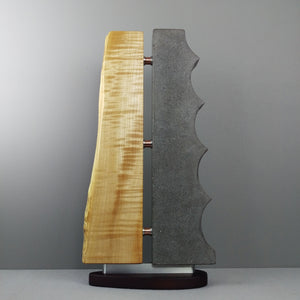 Blond live edge maple and gray cast concrete sculpture with copper and aluminum details.