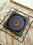 Trivet with a mandala art print on a ceramic tile