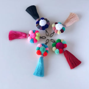 Handmade pom pom cluster key ring finished with matching colour tassel, available in red, pink, turquoise, white and black colour ways