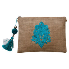 Load image into Gallery viewer, Small hessian clutch with neon turquoise appliquéd motif on front and pom pom tassel attached to the zipper closure