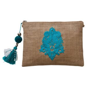 Small hessian clutch with neon turquoise appliquéd motif on front and pom pom tassel attached to the zipper closure