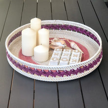 Load image into Gallery viewer, Large woven white rattan tray featuring circular woven pattern on base of tray and braided motif pattern around the raised side, available in either purple or blue colour ways