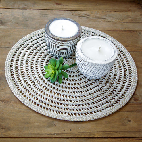 Round open weave natural rattan table centrepiece/placemat with whitewashed finish.